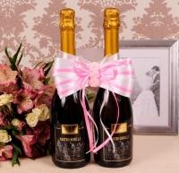 розовый бант на двебутылки свадебного шампанского
