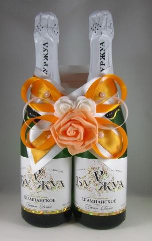 оранжевое украшение на шампанское фото
