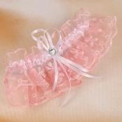 подвязка розовая фото