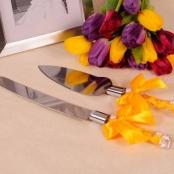 нож и лопатка для торта желтые
