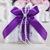 подушечка для колец с фиолетовым бантом фото